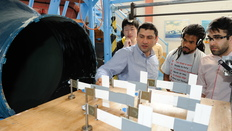 Staff and students by wind tunnel