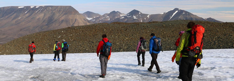Students walking across a snowy mountain
