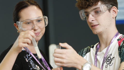 Student and academic doing science experiment