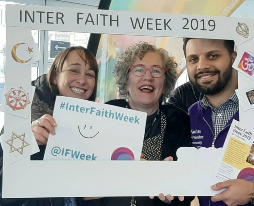 Group shot standing in Inter Faith Week frame