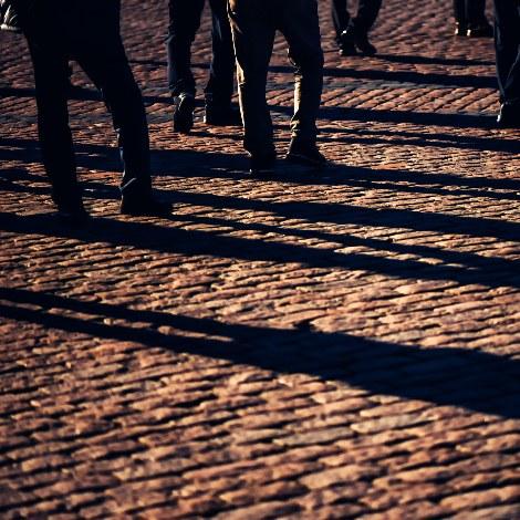 Shadows of crowd walking