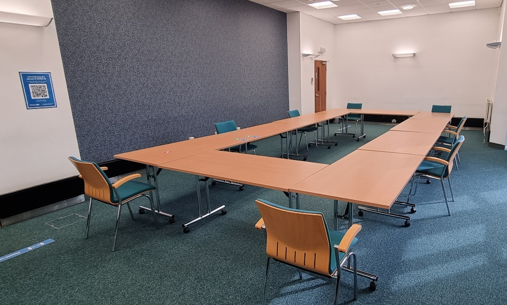 Seats spaced around table