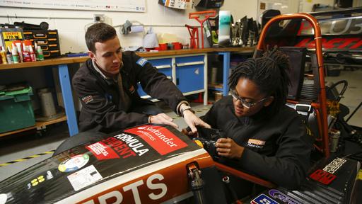 Female student in race car