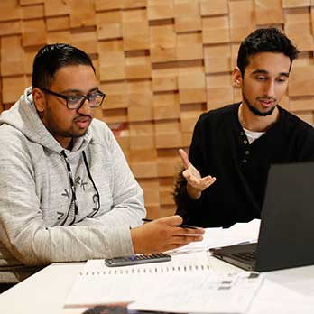 Two students studying with laptop