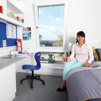 Student in accommodation room