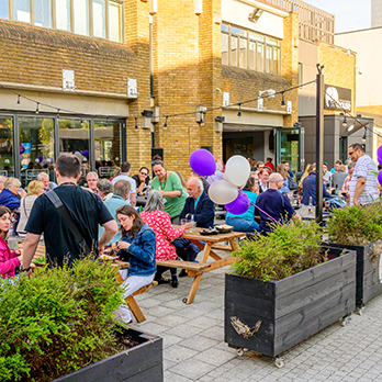 People celebrating outside of pub