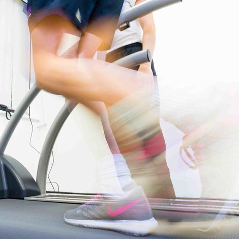 Student running on treadmill