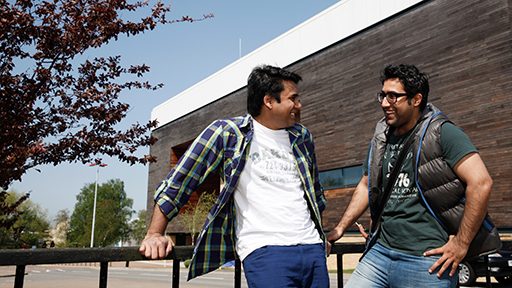 Two male students chat outside