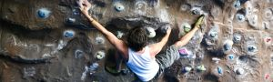 a climber uses the climbing wall at Herts