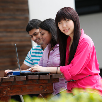 Three international students studying