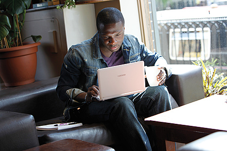 Postgraduate student looking at laptop