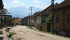 Typical Drăguș village streetscape – before renovation Photograph: Mihai Racu