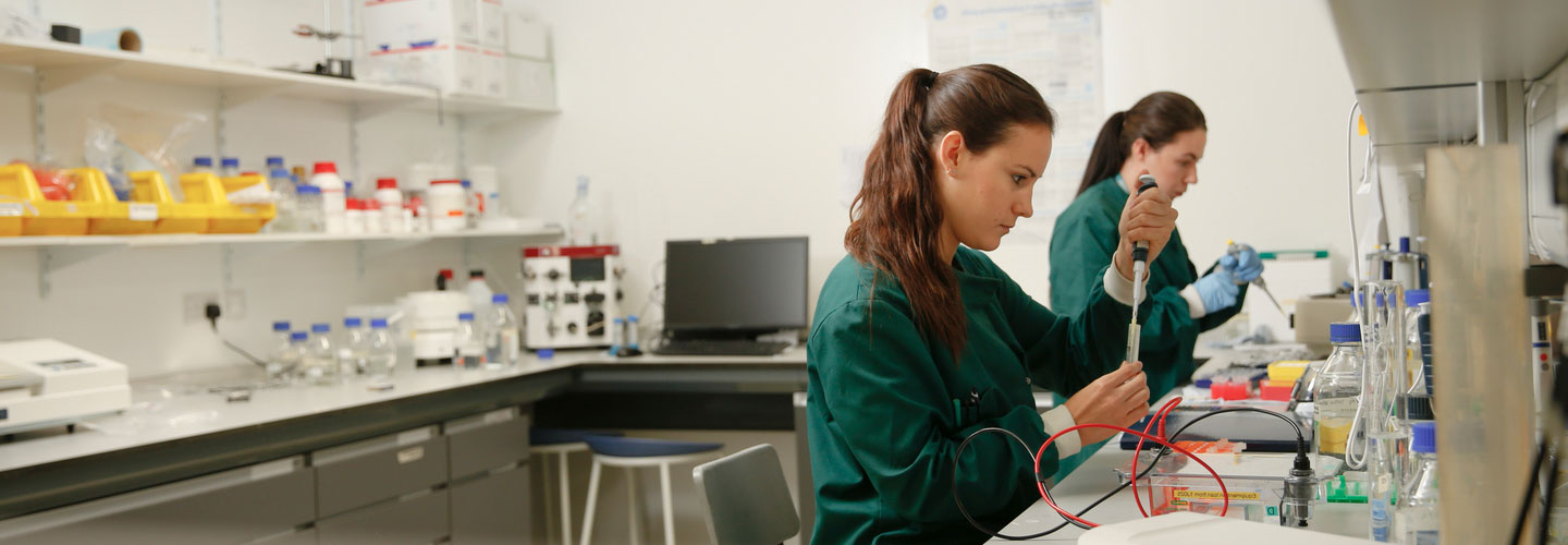 Two female biochemistry students working in a lab