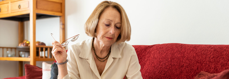 Mature woman on sofa