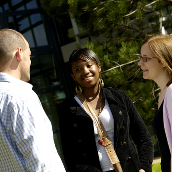 Three students socialising on campus