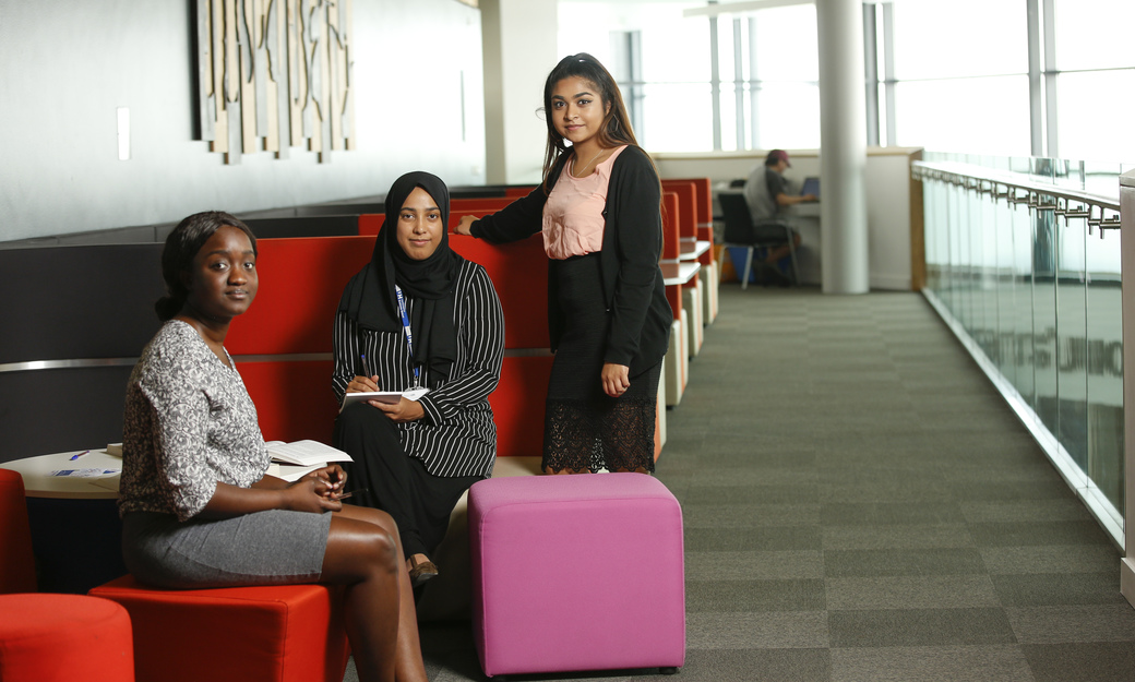 Group of students sitting on sofas