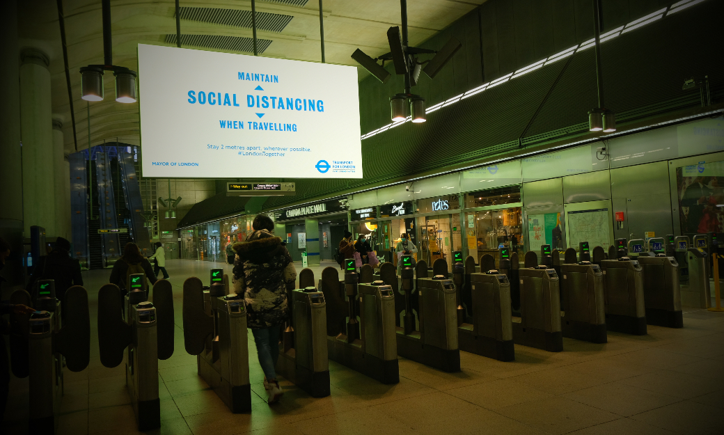 Social distancing sign in train station