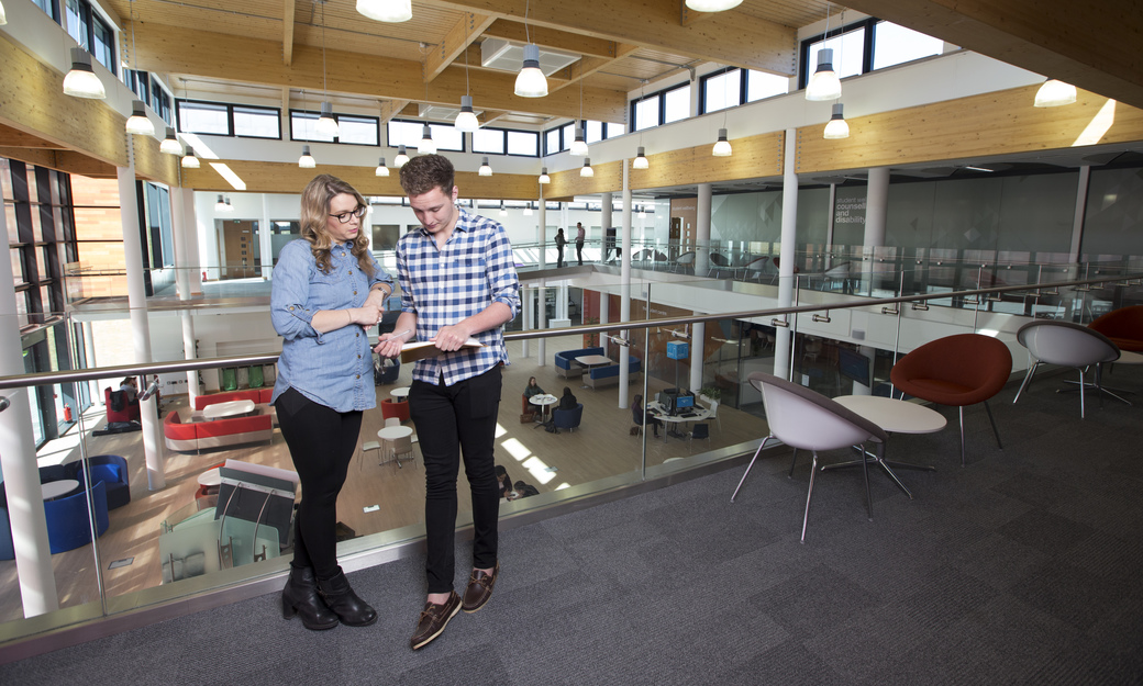 Male and female student talking in Hutton Hub