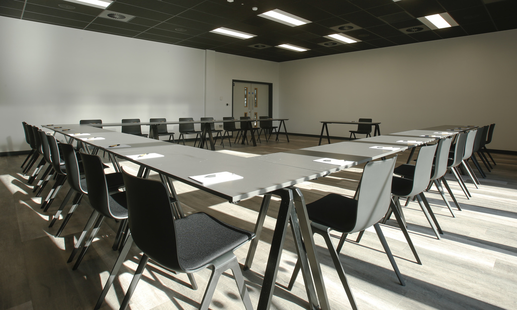 Large meeting with tables in square