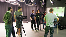 film and TV students with camera