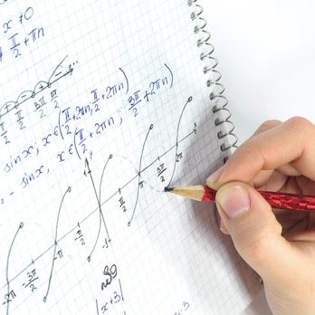 Student writing equations