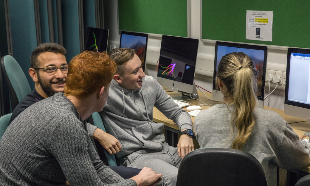 Group of students around computer