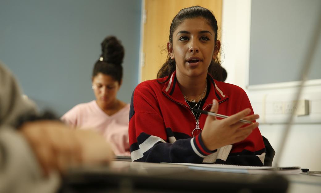 Student debating in class