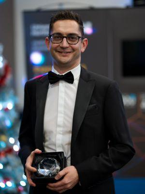 Joe Wilkins receiving his entrepreneurship award