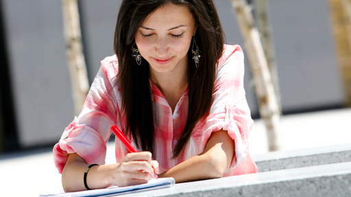 Female student filling out an application form