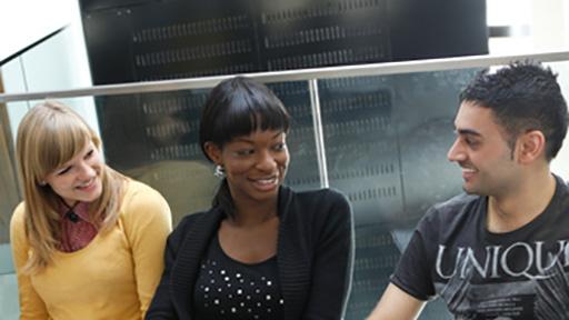Students sitting on floor talking
