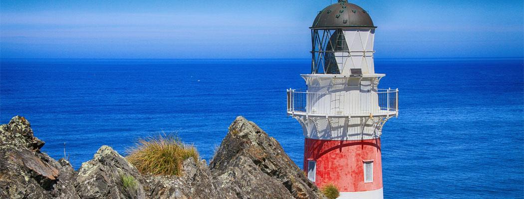 Lighthouse next to sea