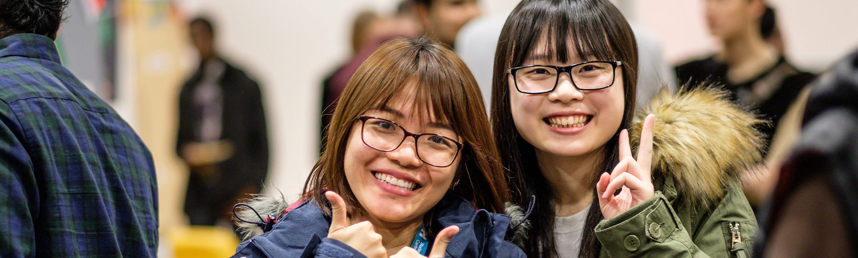 Two female students at event on campus