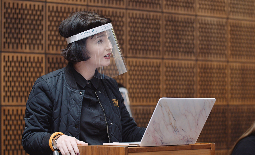 A law student wearing a face shield, takes part in a mock trial in our law court