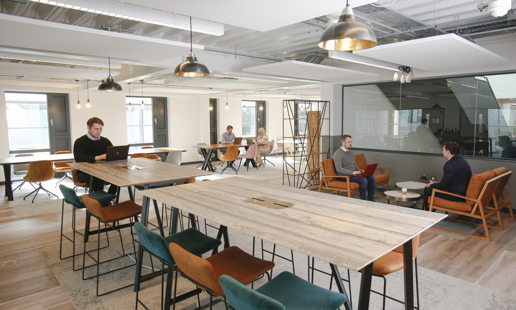Social space with people working in