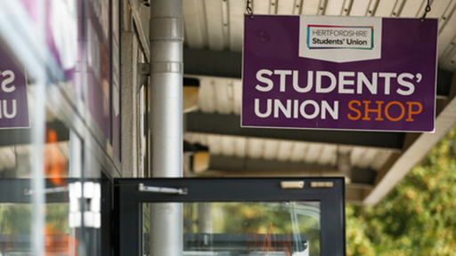 a sign for the student union shop