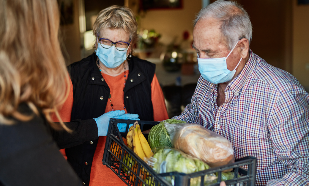 Older adult receiving a food parcel during the pandemic