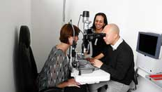 optometry students with a patient