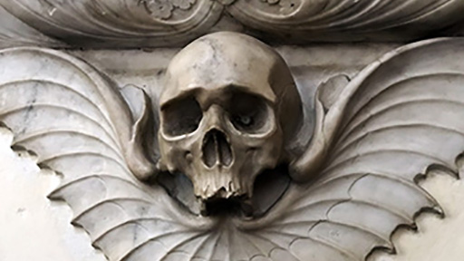 Winged skull carving in St Albans Cathedral