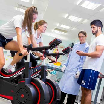 sports therapy students with women on treadmills