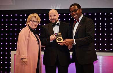 Theo Gilbert collecting award