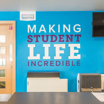 Making student life incredible text on wall