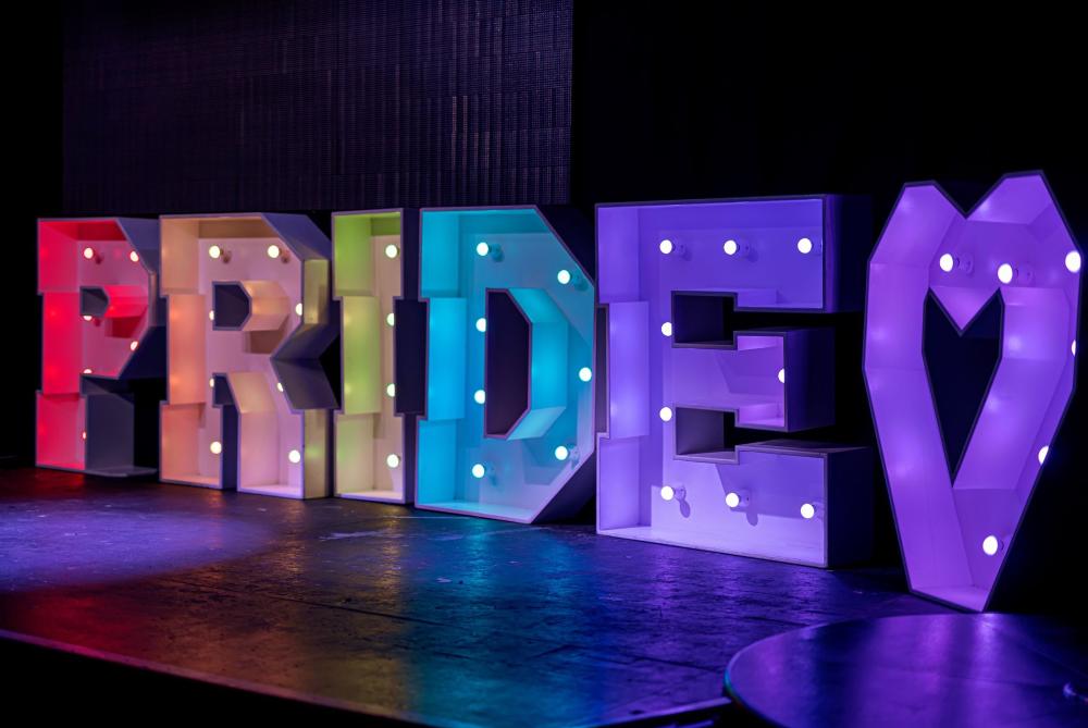 Pride signage in multicoloured lights