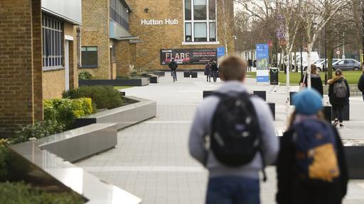 Students walking through College Lane campus
