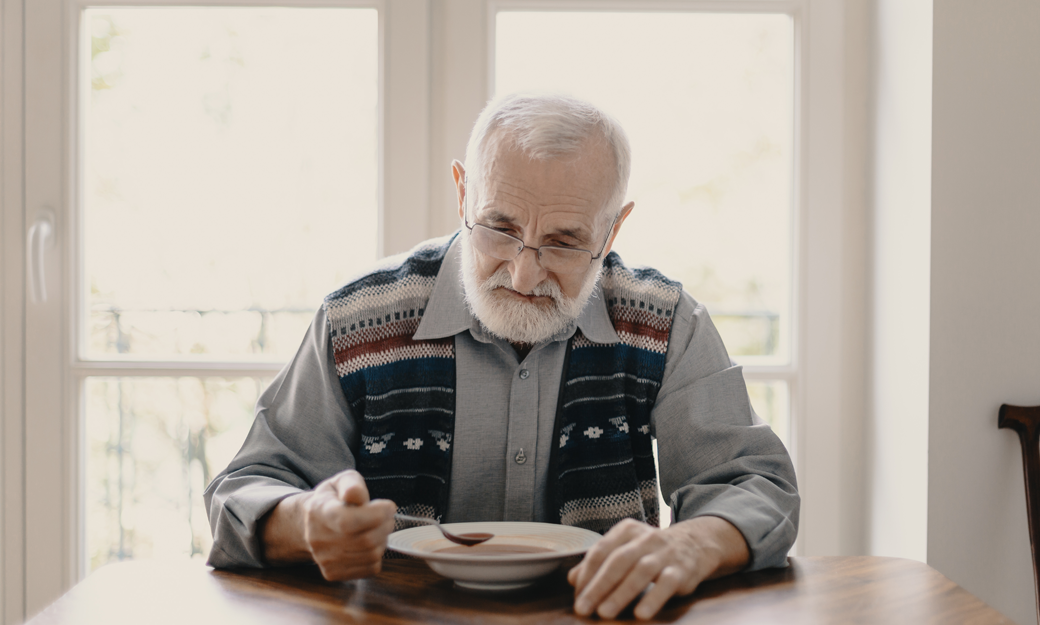 Older adult eating a meal alone
