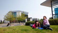 Students by the de Havilland campus in Hatfield