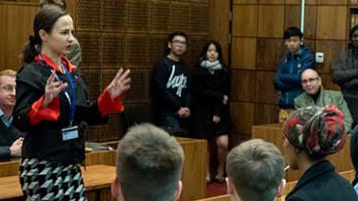 Academic debating in front of students in law court
