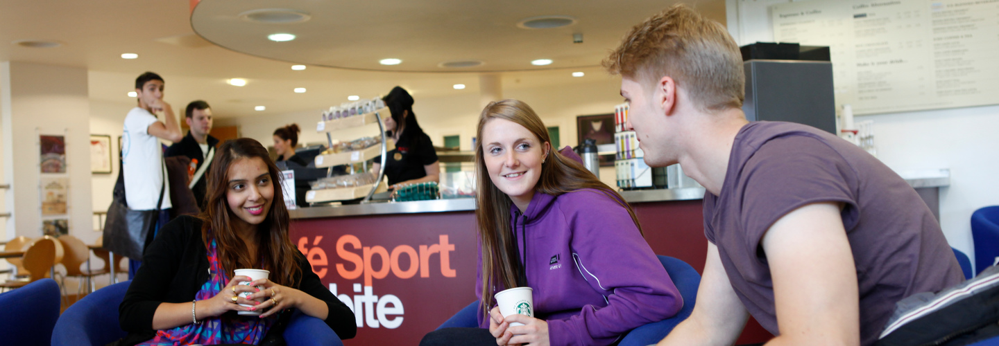 Students meeting sitting on the sofas in the Sports Village