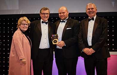 Rob Chilcott collecting award