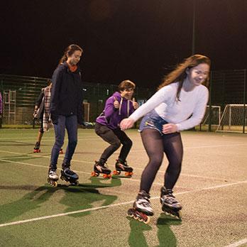 Female students rollerblading