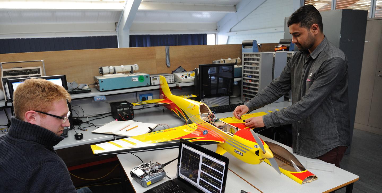 Students working on model aeroplane